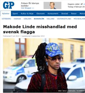 20140705 Makode Linde misshandlad med svensk flagga